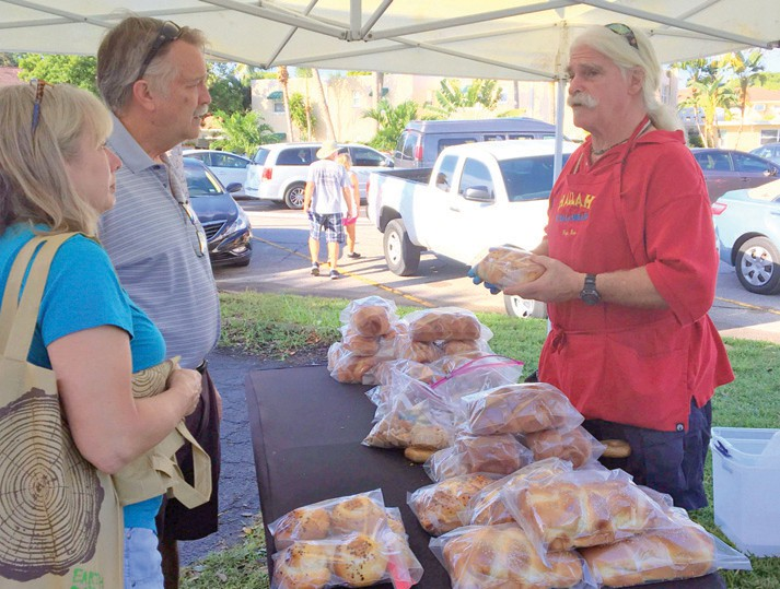 Onwer Ron Baca, right, talks to customers at the Baca Bread booth. ANNALEE HALL / WELLEN PARK JOURNAL